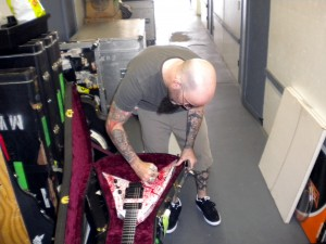 Scott Ian of Anthrax signs his guitar pre-auction. Photo courtesy of Backstage Auctions.